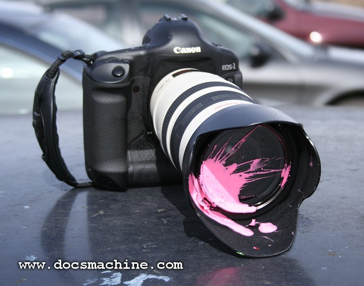 Splattered Canon camera and lens, 2006